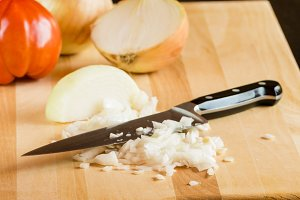Diced onions with knife and tomato