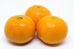Closeup of Three Clementines