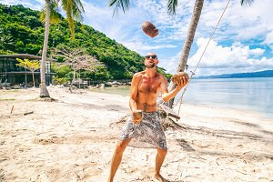 Juggling coconuts on the beach