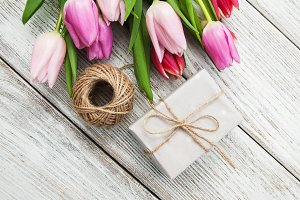 Spring tulips flowers and gift box
