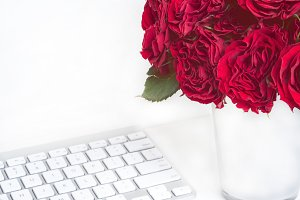 Feminine workplace with red roses