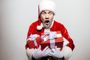Shocked man santa claus with presents standing