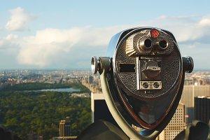 Binoculars overlooking Central Park