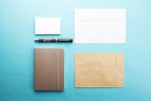 Office supplies on blue background. Envelopes. Mockup.