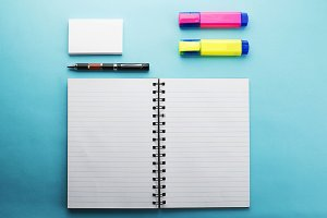 Office supplies on blue background. Mockup.
