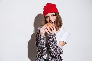 Hungry woman holding burger