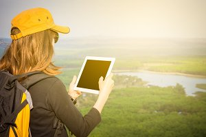 Tourist woman looking map on tablet.