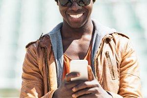 American man using mobile.