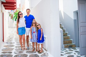 Family vacation in Europe of typical greek traditional village on Mykonos