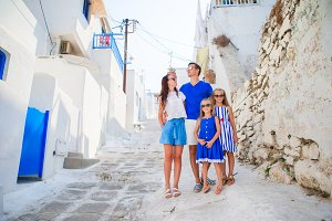Happy family of four in Greece