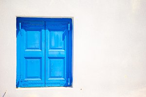 Traditional colorful window in the narrow streets of Mykonos, Greece.