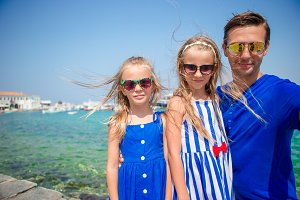 Family vacation in Europe. Father and kids taking selfie background Mykonos town in Greece