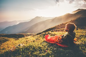 Man relaxing in sleeping bag travel