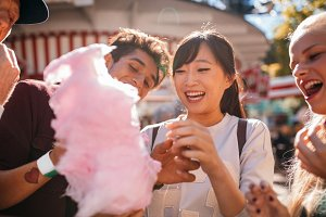Young people sharing cotton candy