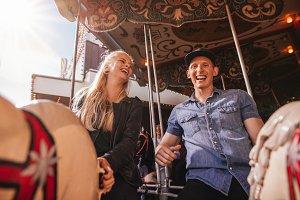 Smiling friends on amusement park