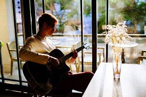 asian artist man play guitar