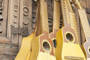 small yellow colored guitars