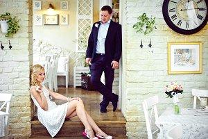 Groom stands over a bride