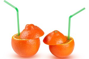 two oranges with green coctail straw isolated on white background