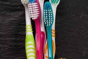 toothbrushes on the black stone background