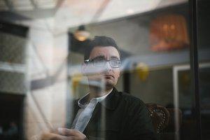 Man behind a glass