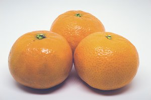 Matte Closeup of Three Clementines