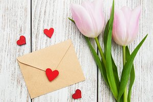 Spring tulips flowers and envelope