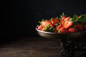 Fresh strawberries on vintage scales
