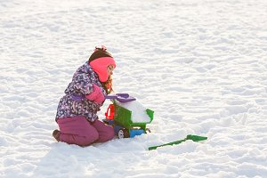 Kid play on the snow