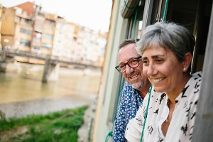 Mature couple looking out of window