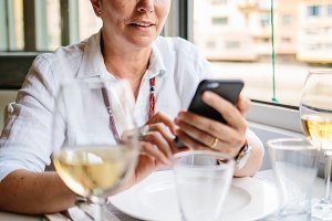 Mature female browsing phone