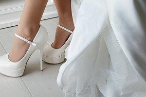 Closeup of bride's seductive legs