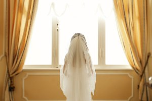 Look from behind on gorgeous bride