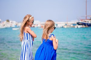 Adorable little girls on summer vacation in Greece