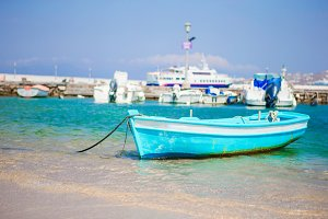Small blue and white color fishing boat in port on island of Greece