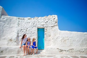 Mother and kids in Mykonos town in Greece
