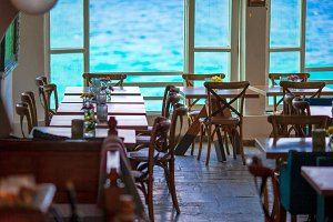 Summer empty openair cafe with beautiful view to the sea in popular area in Mykonos Little Venice