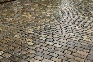 Wet cobblestone street