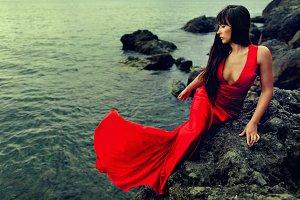 Long hair woman posing in sea water