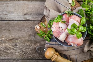 Raw chicken legs for bbc with herbs and spices