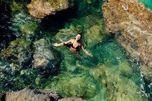 sexy woman swim in the sea lagoon