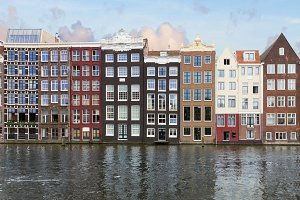 houses over canal waters, Amsterdam
