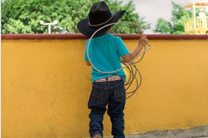 young mexican cowboy with lasso