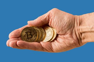 Stack of bitcoins with blue background