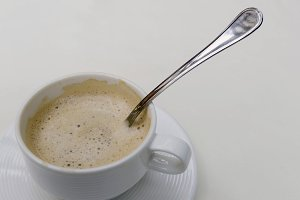 Spoon into a coffee cup