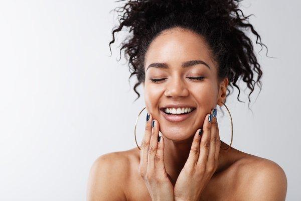 Studio portrait of a happy woman