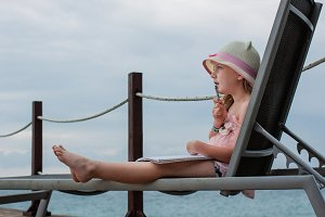 young girl in lounge chair