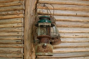 vintage lamps on a wooden fence