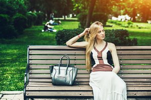 Woman on bench in park