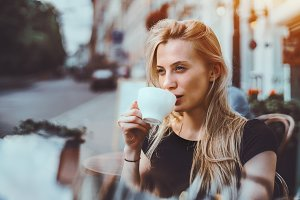 Blonde woman with cup of tea